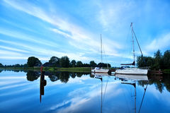 Yachts on river during calm morning Royalty Free Stock Image