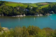 Yachts on the River Dart near Dartmouth. Yachts sailing on the River Dart near Dartmouth.  This is the mouth of the Dart Etuary and photographed from the South Royalty Free Stock Photos
