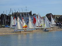 Yachts and sail boats on whitstable beach. Photo of yachts and sail boats sails blowing in the wind at whitstable harbour sailing club taken on 29th sept 2018 stock image