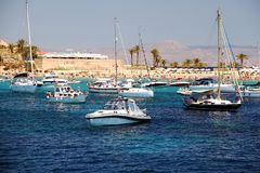 Transparent water in the anchorage of Tabarca Island in Spain. Stock Photography