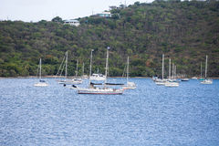 Yachts and Sailboats off Lush Green Hillside Stock Photos