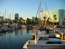 Yachts, Sailboats and Speedboats docked by Shoreline Village, Rainbow Harbor, Long Beach, California. USA Royalty Free Stock Images
