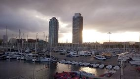 Yachts and sailboats with view to Skyscrapers Torre Mapfre stock video footage