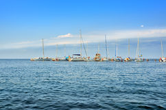 Yachts and sailing boats are on the dock. Stock Image
