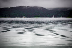 Yachts sailing on calm sea Stock Photo