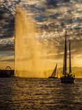 Yachts sailing into the harbour of Geneva, Switzerland at sunset. stock image