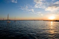 Yachts sailing in ocean Stock Photos