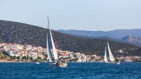 Yachts at Sailing regatta at the Aegean Sea near the Greek Islands. Royalty Free Stock Images