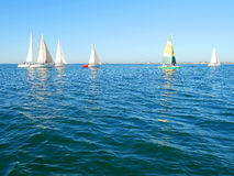 Yachts sailing on the sea Stock Photos