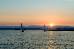 Yachts sailing at sunset Stock Photo