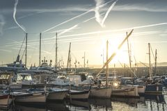 Yachts in Saint-Tropez bay. At sunset royalty free stock photos