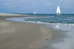 Yachts, sandbank and Wadden Sea Royalty Free Stock Photo