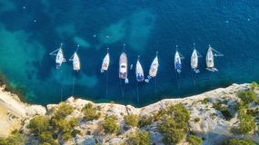Yachts at the sea in France. Aerial view of luxury floating boat on transparent turquoise water at sunny day. royalty free stock photos
