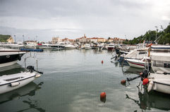 Yachts on the sea pier of the Adriatic Sea. Yachts at sea pier in the background of the city Budva Stock Images