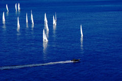 Yachts in the sea. Yachts sailing on the sea, and the boat floats intercept they Royalty Free Stock Photography