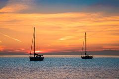 Yachts in the sea at sunset time Stock Images