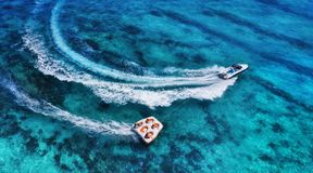 Yachts at the sea surface. Aerial panoramic view of luxury floating boat on transparent turquoise water at sunny day. Top view fro. M drone. Seascape with royalty free stock photo