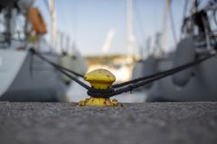2 yachts secured on a metal bollard stock photography