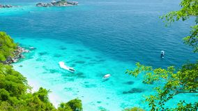 Yachts in shallow water near the tropical island. View from the mountain. Thailand, Similan stock footage