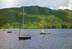 Yachts in a sheltered harbor in the caribbean Stock Photos