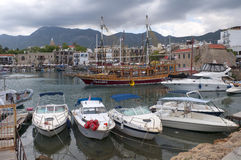 Yachts and ships in the old harbour of Kyrenia cloudy day. North Cyprus Stock Photo