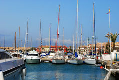 Yachts in Sotogrande marina. Yachts and boats in the marina with buildings to the rear, Puerto Sotogrande, Cadiz Province, Andalucia, Spain, Western Europe Stock Photos