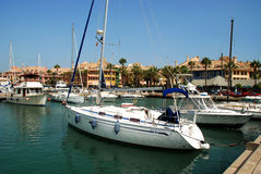 Yachts in Sotogrande marina. Yachts and boats in the marina with buildings to the rear, Puerto Sotogrande, Cadiz Province, Andalucia, Spain, Western Europe Royalty Free Stock Photos