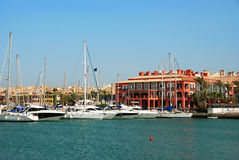 Yachts in Sotogrande marina. Yachts and boats in the marina with buildings to the rear, Puerto Sotogrande, Cadiz Province, Andalucia, Spain, Western Europe Stock Image