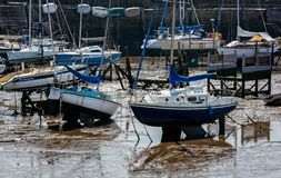 Yachts stranded at high tide. Yachts stranded at low tide on mud flats - taken in Scarborough, Yorkshire, UK on 20 May 2018 royalty free stock photo