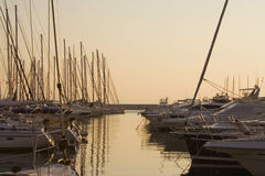 Yachts in a marina at the sunset. Yachts in a marina at sunset. Alimos marina, Athens - Greece Stock Photo