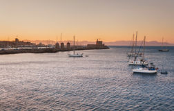 Yachts at sunset in the Mediterranean Sea near the Mandraki harbor. Rhodes Island. Greece. Attraction of the island of Rhodes is the capital of the ancient port royalty free stock photo