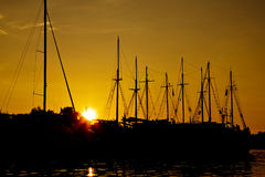 Yachts sunset silhouettes Royalty Free Stock Photo