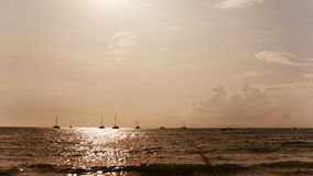 Yachts sunset. Silhouettes of yachts. Silhouettes in the distance Royalty Free Stock Photo