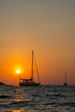 Yachts in sunset. Yachts spending a night in a bay. Orange skies stock photography