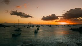 Yachts in the sunset sun. Still water Orange sky. Yachts in the sunset sun. Still water. Orange sun and clouds Stock Image