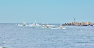 Yachts traffic season new jersey state usa. There are numerous yachts of anglers and ocean trip fans nearby shoresite of Atlantic ocean , where is border of one royalty free stock images