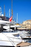 Yachts in Vittoriosa marina, Malta. Luxury yacht moored in the marina with Fort St Angelo to the rear, Vittoriosa, Malta, Europe Stock Image
