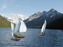 Yachts with white sail on the lake in the mountains royalty free stock photo