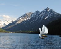 Yachts with white sail on the lake in the mountains royalty free stock photos