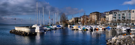 Yachts on winter parking lot on Lake Genev Stock Photography