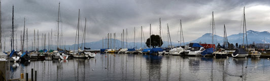 Yachts on winter parking lot on Lake Geneva Royalty Free Stock Photography