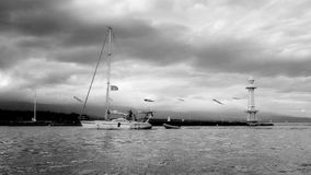 Yachts. Yacht sailing on the lake. Lake Geneva. Early autumn. Cool and cloudy evening in Geneva. Switzerland Stock Photo