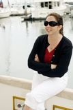 Yachtswoman. A gracious woman on her yacht Stock Images