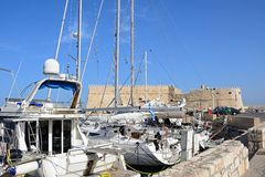 Yacts and castle, Heraklion. Royalty Free Stock Photos