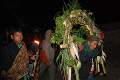 YADNYA KASADA FESTIVAL. A number of Tengger Hindus bring an offering that will be floating during the Yadnya Kasada festival on the slopes of Mount Bromo in Stock Photography