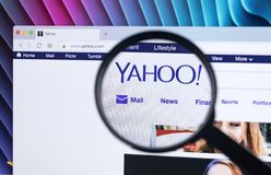 Yahoo homepage website on iMac monitor screen under a magnifying glass. Yahoo is a multinational Internet corporation with search. Sankt-Petersburg, Russia Royalty Free Stock Images