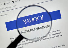 Yahoo Notice of data breach. MONTREAL, CANADA - DECEMBER 15, 2016 : Yahoo Notice of data breach under magnifying glass Royalty Free Stock Photos