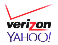 Yahoo and Verizon Communications logos printed on white paper. Kiev, Ukraine - July 26, 2016: Yahoo and Verizon Communications logos printed on white paper Stock Images