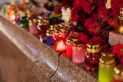 Yahrzeit candles and flowers at the Independence Square in Kiev Royalty Free Stock Images
