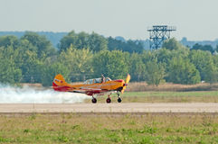 Yak-52 plane from Pervyj Polyot display lands Stock Photos